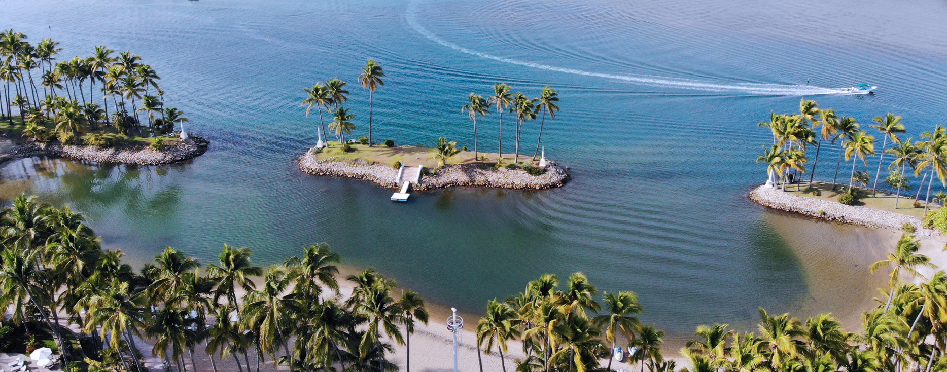 Aerial view of water, boat, and palm trees | Mexico Cruising Guide | Snag-A-Slip