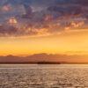 Sailboat on Elliott Bay in sunset, Seattle, WA, USA | Isolation Inspiration | Snag-A-Slip